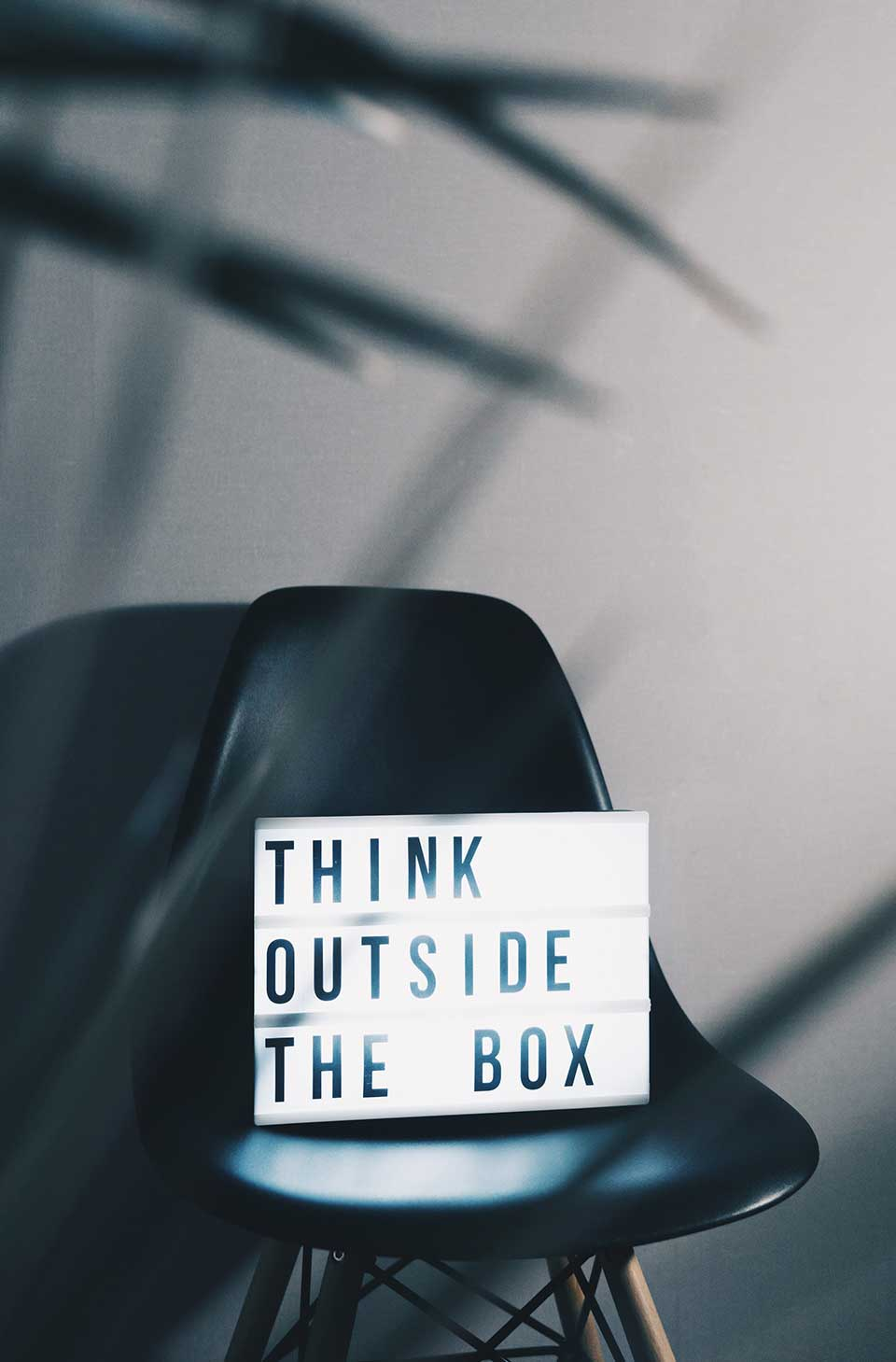 a sign that reads think outside the box when thinking about blogging