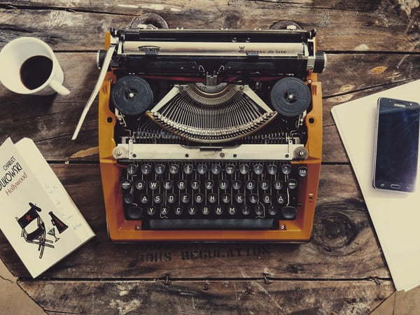 coloured typewriter on a rustic desktop