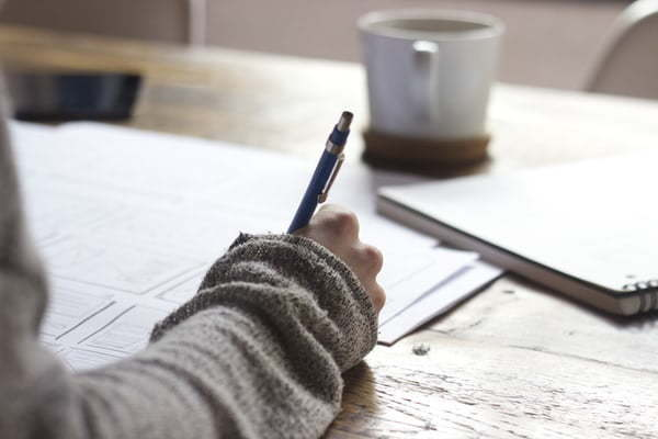 woman writing a journal