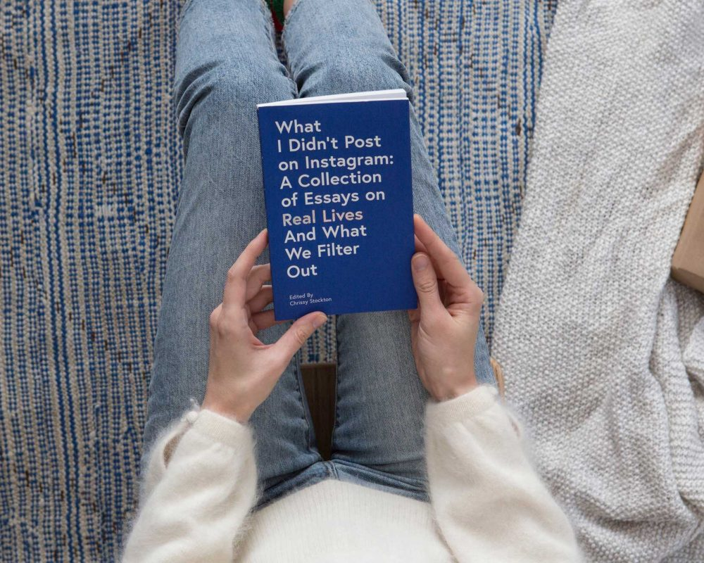 woman with a book of things that weren't posted on instagram