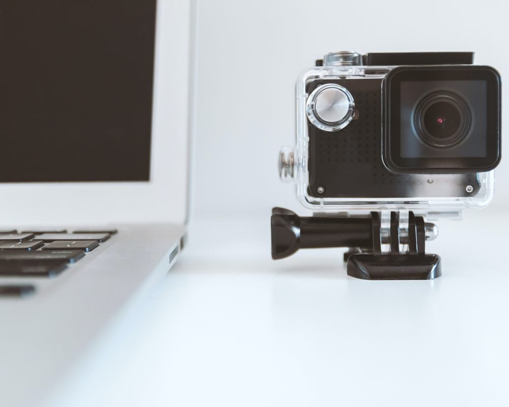 Go Pro camera set up by laptop, ready to record a video for marketing.